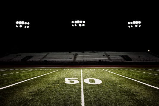Fifty Yard Line Of Football Field At Night