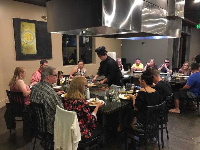 Diners at teppanyaki tables at Kobe Seafood and Steak in Redding.