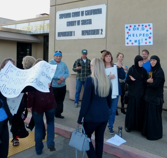 Supporters of chiropractor Steven Davis gather Friday outside the Shasta County Justice Center in Redding.