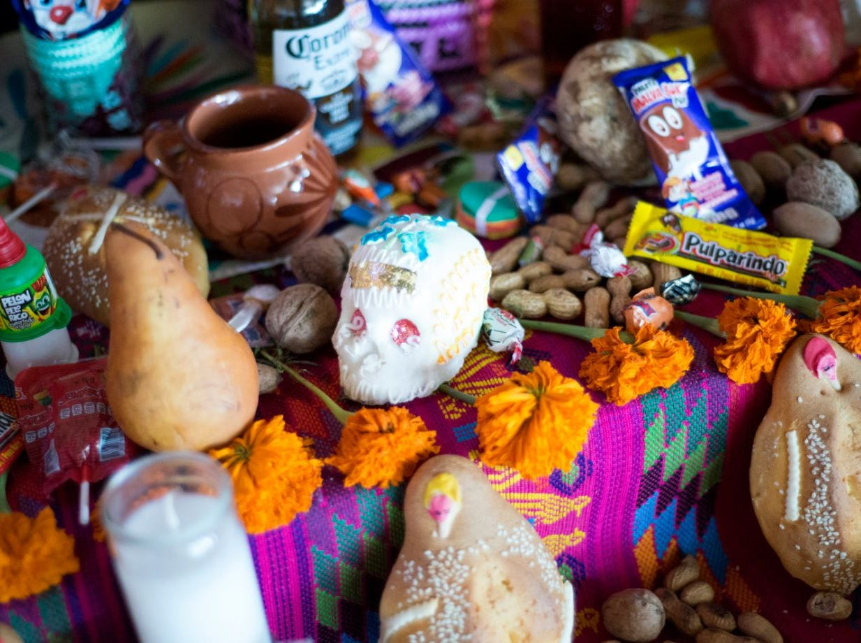 The traditional altar at Culturas Hidalgo y Oaxaca is full of offerings to dead ancestors Oct. 25, 2018. The dead are said to return on Dia de Muertos to see their families and partake of food and drinks they enjoyed while they were alive.