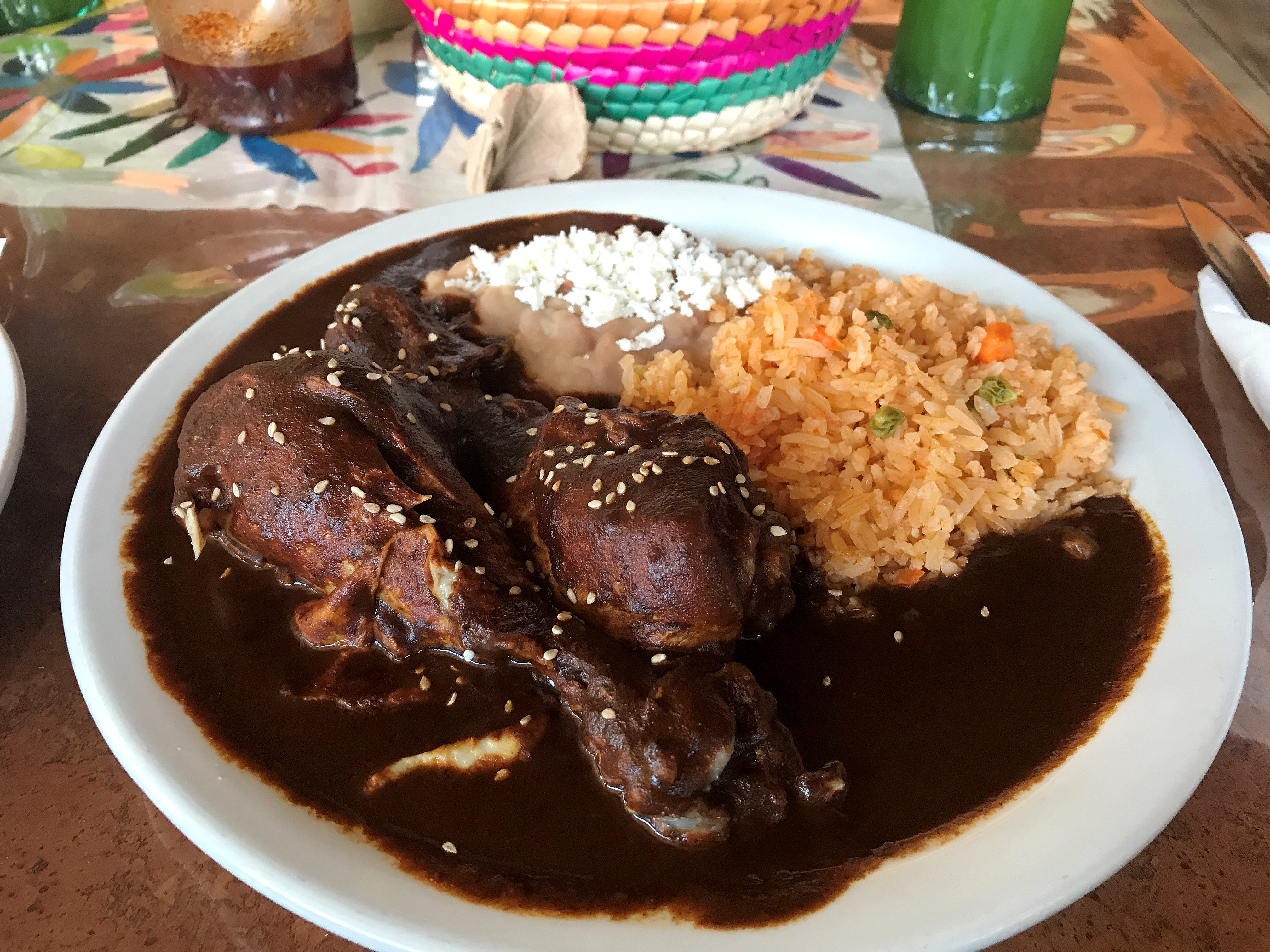 Chefs at Culturas Hidalgo y Oaxaca restaurant used a family recipe to make this homemade style earthy and bittersweet chicken mole Oct. 25, 2018. They also offer pascal, a green mole dish.