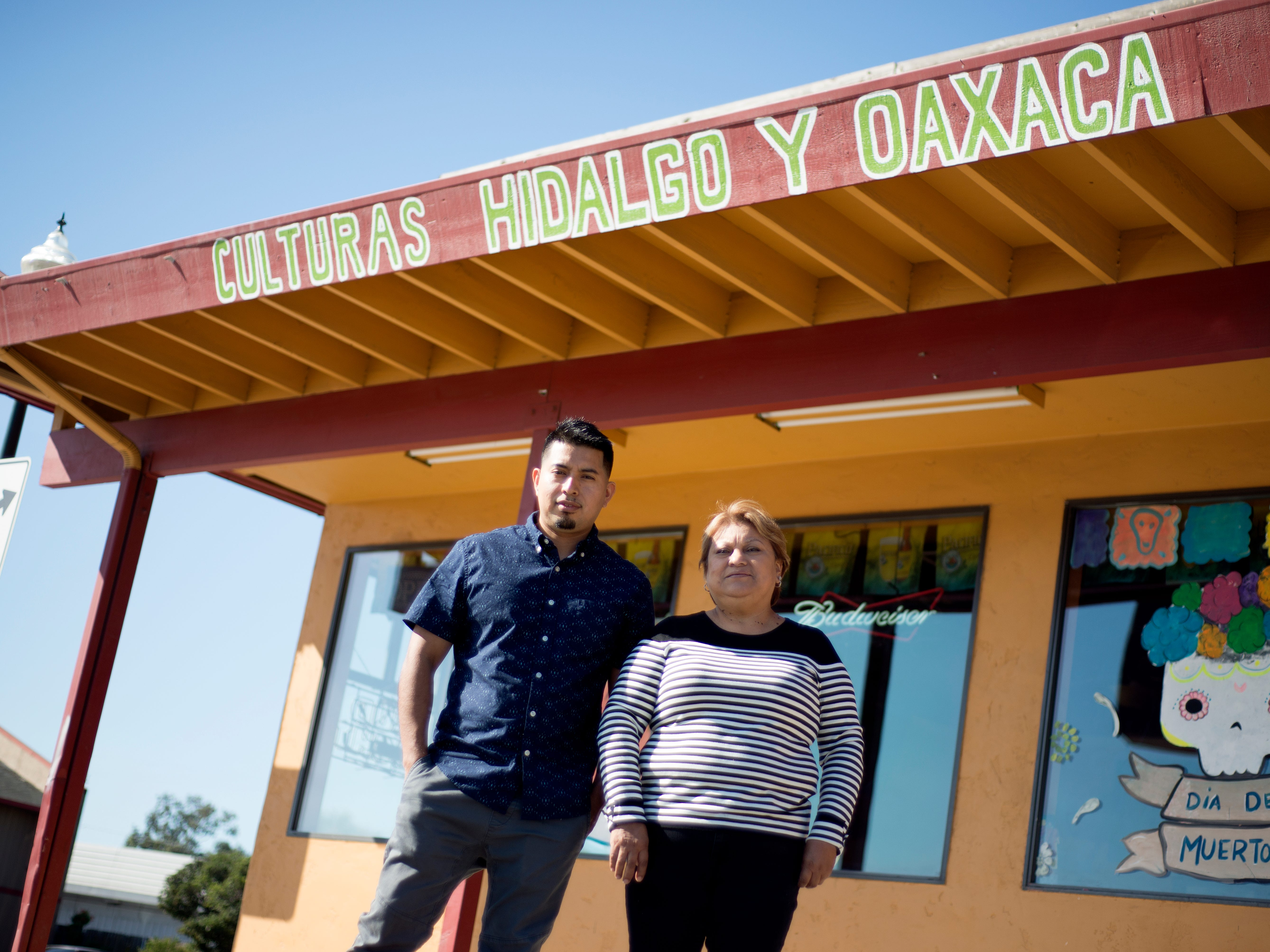 Roman Monjaraz, left, and Martha Tapia, right, stand in front of Culturas Hidalgo y Oaxaca, the restaurant they co-own, Oct. 25, 2018.
