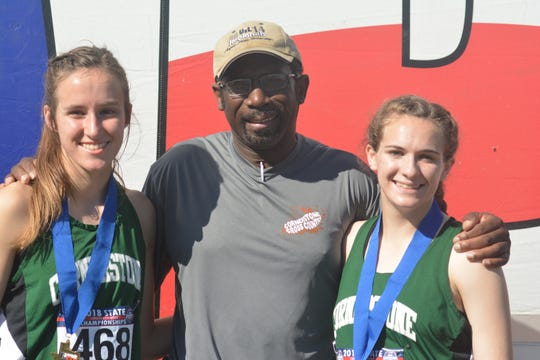 Cornerstone Christian School's Hannah Slate, left, and Jessica Simon, right, competed at the TAPPS State Cross Country meet for the final time, Monday, Oct. 29, 2018. Their coach is Gary Gabriel, center.