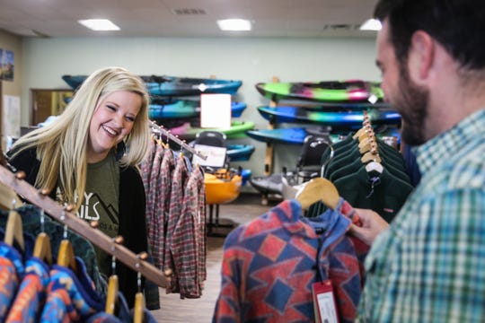 Owners Colby and JessicaChesshire laugh as they talk about the store Friday, Nov. 2, 2018, at Happy TrailsOutdoor Goods & More.