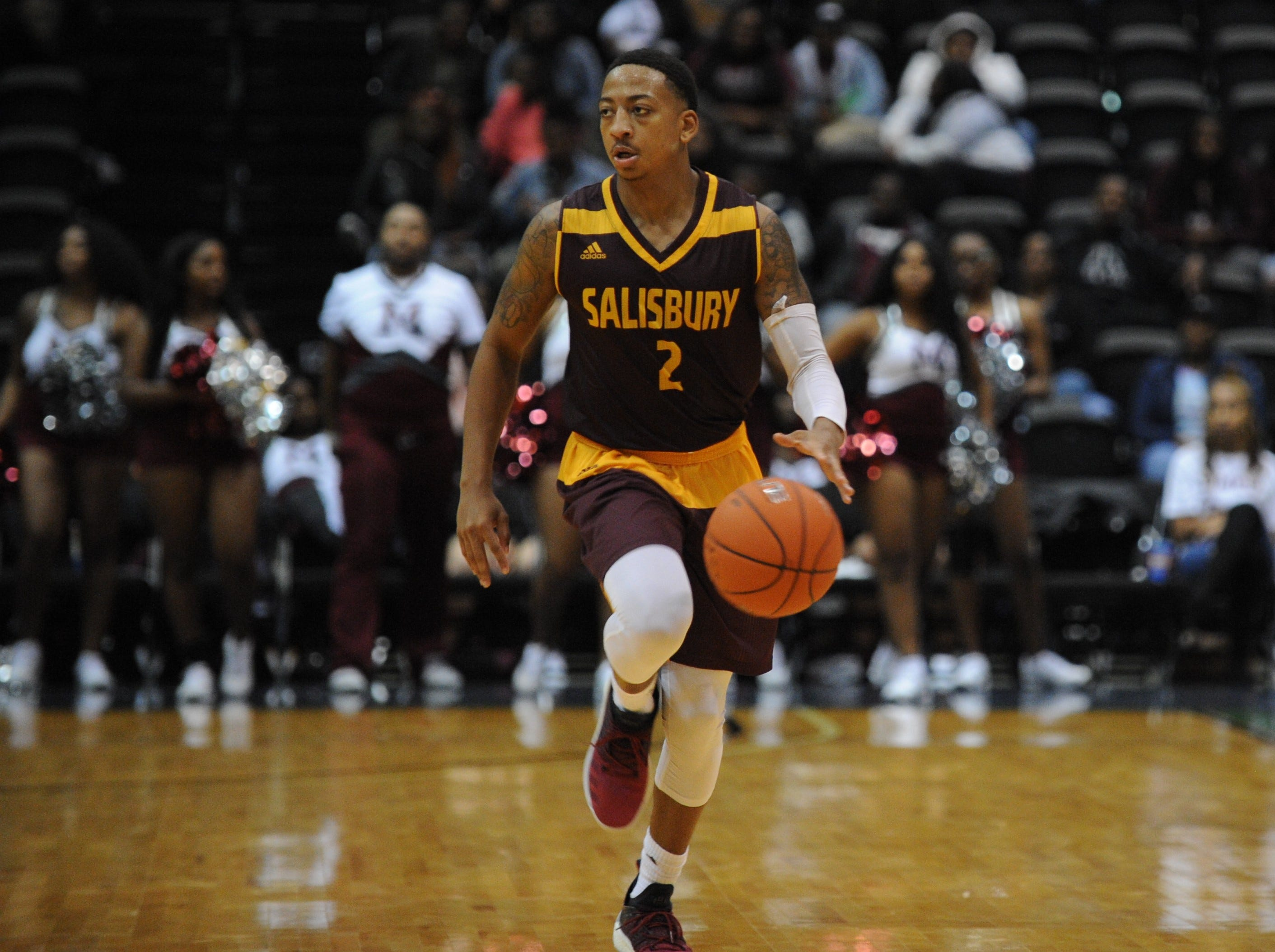Salisbury University guard Blair Davis takes the ball up court against the University of Maryland Eastern Shore during the 10-Mile Tipoff on Thursday, Nov. 1, 2018. The Sea Gulls won, 67-60.