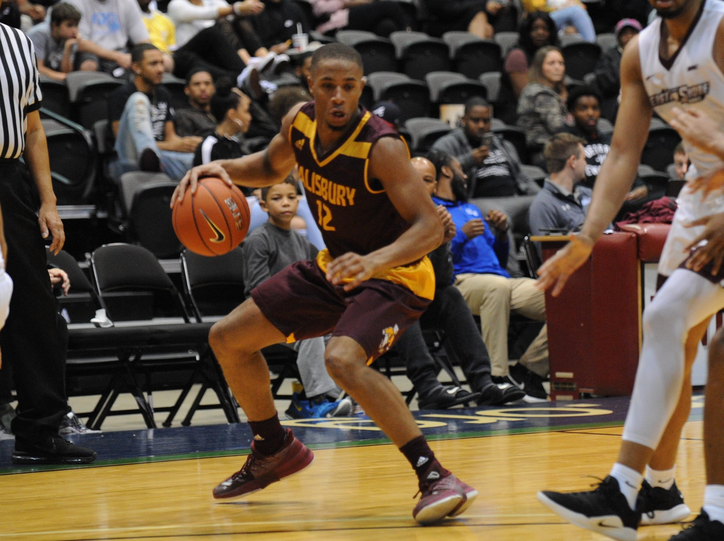 Salisbury University guard Mike Ward takes a step back against the University of Maryland Eastern Shore during the 10-Mile Tipoff on Thursday, Nov. 1, 2018. The Sea Gulls won, 67-60.