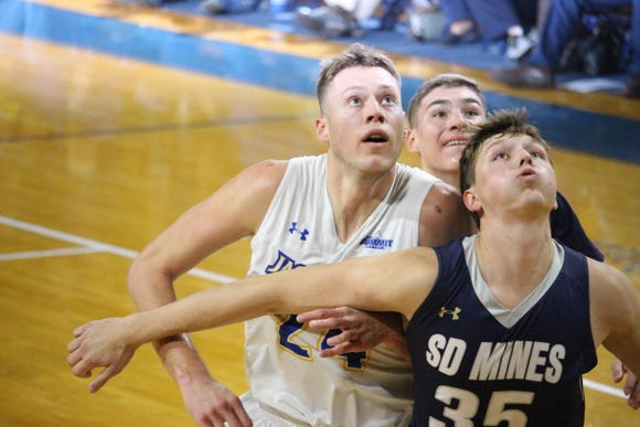 Mike Daum battles SDM&T's Mitchell Sueker for a rebound Thursday night.