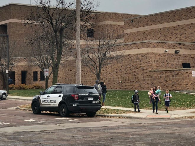 Kids are seen leaving Lowell Elementary after a shelter in place order caused by a weapons violation nearby the school on 18th Street.