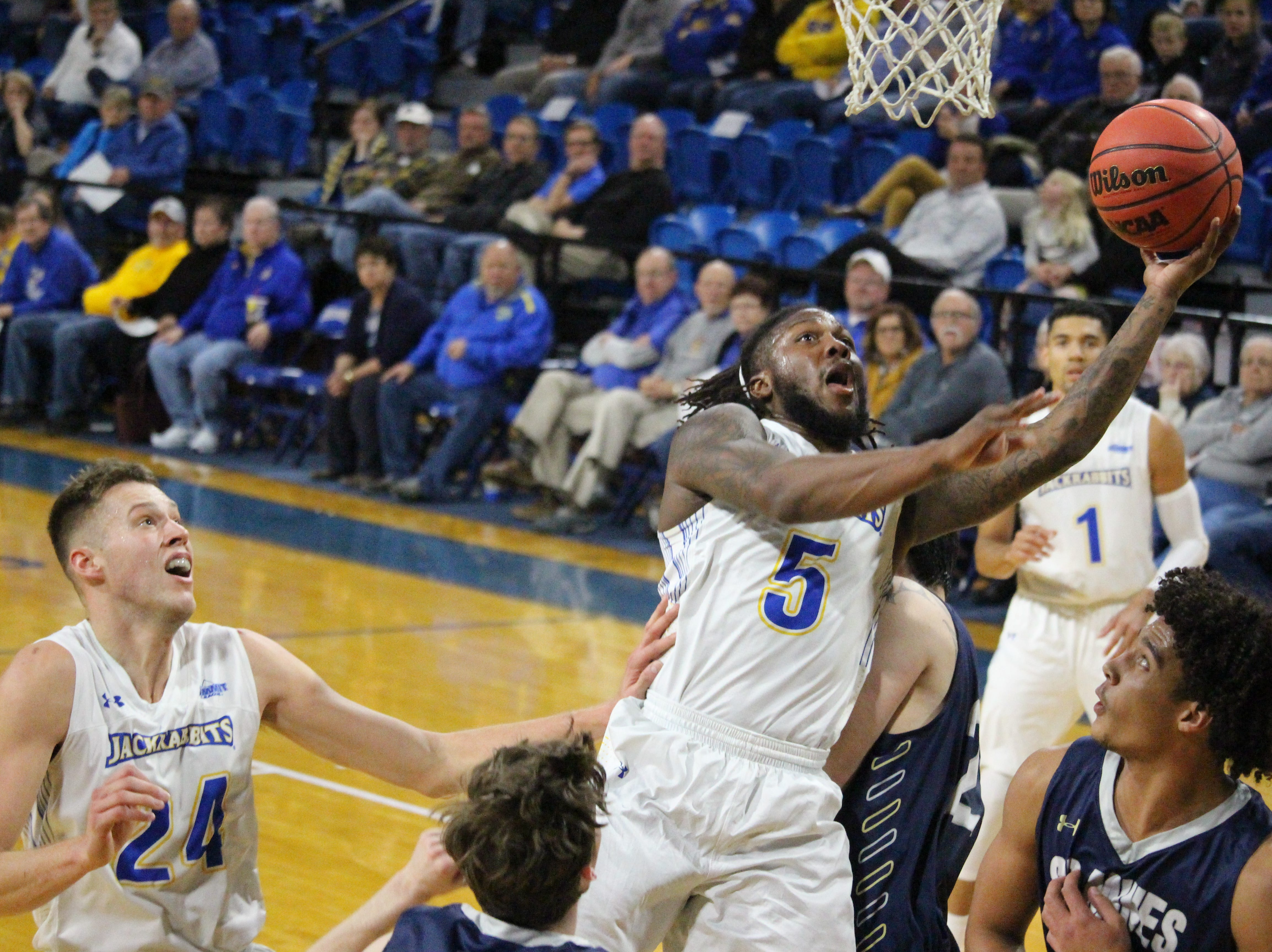 SDSU's David Jenkins takes it to the basket Thursday night against South Dakota Mines & Technology at Frost Arena
