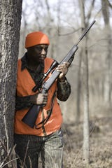Phil Phillip waits for a deer during the deer hunting season.