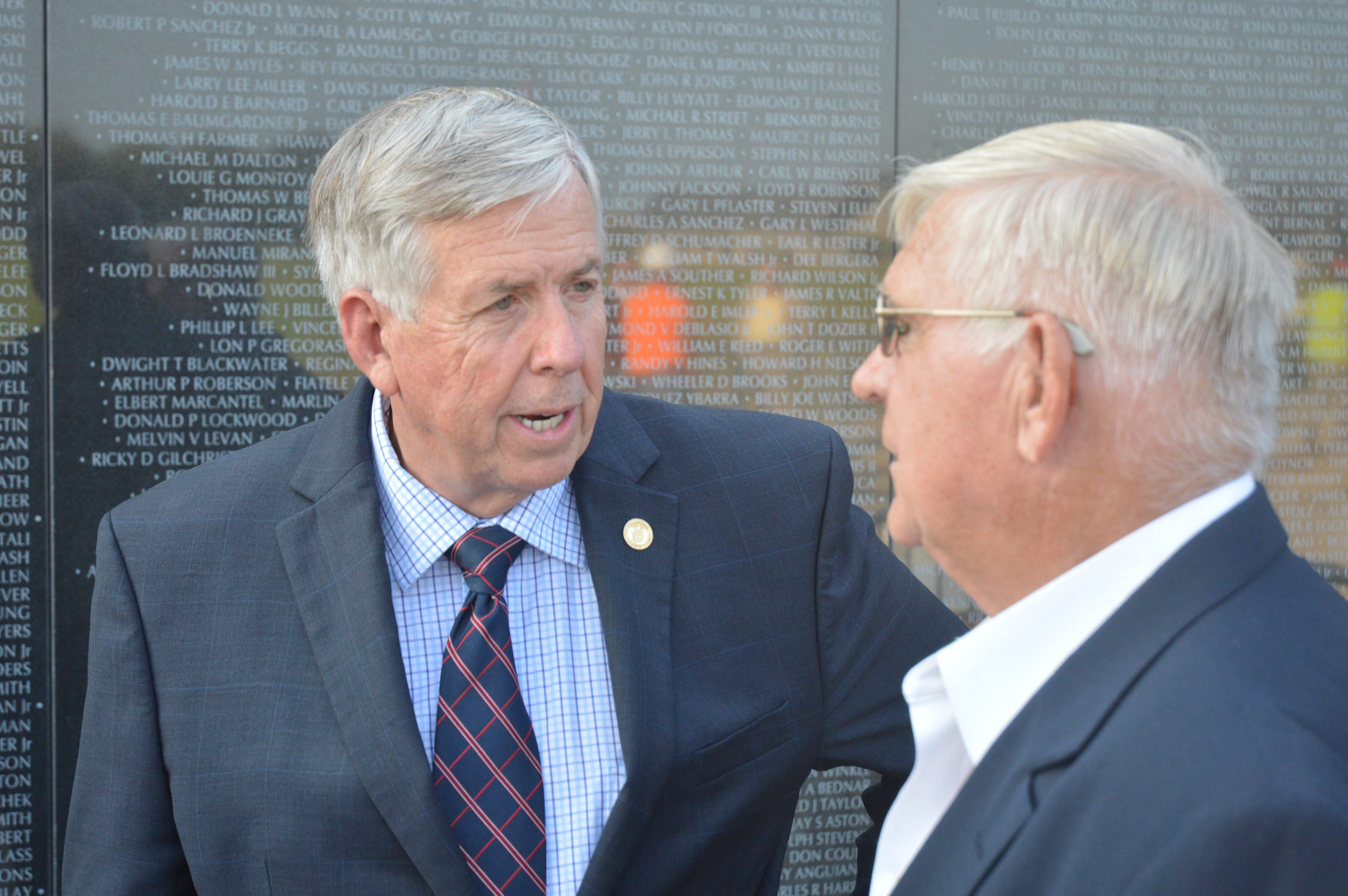 Missouri Gov. Mike Parson (left) speaks with Jim Eddleman on Wednesday, Aug. 27, 2018, during a visit to Missouri's National Veterans Memorial in Perryville. Eddleman, a Vietnam veteran and third-generation Perry County farmer, donated 47 acres of his family farm to the memorial site.  (Photo courtesy of the Republic-Monitor in Perryville.)