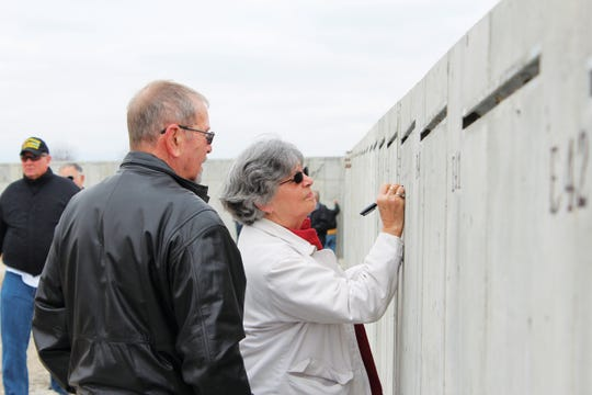 "John and Dorris Buehler of Perryville list the names of several family members who have served in the military Sunday, March 25, 2018, during the ""Mark of Remembrance"" event at Missouri's National Veterans Memorial site in Perryville. ""It's my brother, self, son, and grandson,"" John said. He chose panel E39, the year he was born, so that he could remember the signature's location. The signatures and other remembrances will be left in place as the panels are installed, making them a permanent — if hidden — part of the memorial."