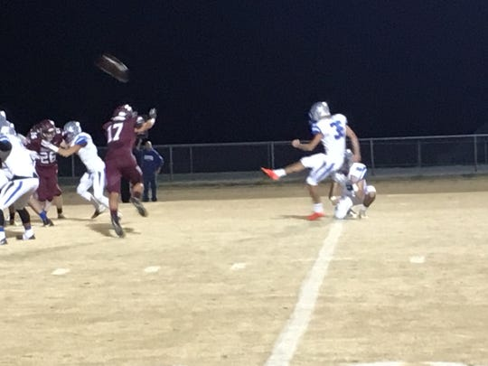 Lee High kicker Marcos Sasia adds an extra point for his team Thursday against Stuarts Draft.