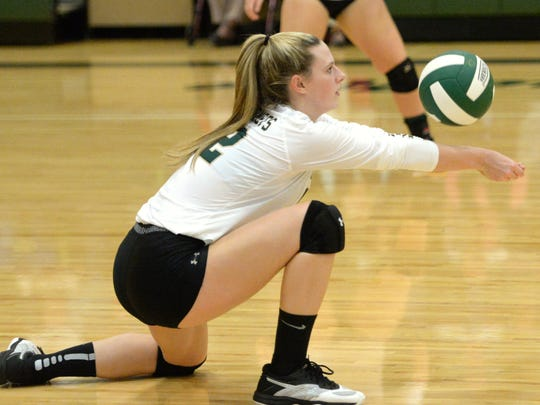 Wilson Memorial's Paris Hutchinson goes low for the ball during Thursday's Region 2B volleyball win over Strasburg.