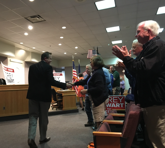 U.S. Senate candidate Corey Stewart shook hands as he walked into the #JobsnotMobs rally Thursday night.