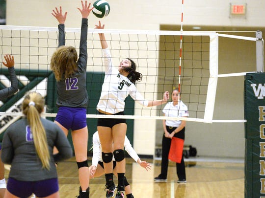Wilson Memorial's Carlee Hatfield (9) with an attack Thursday during the Region 2B volleyball quarterfinals against Strasburg.