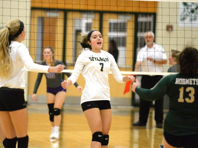 Wilson Memorial players celebrate a point Thursday during a win over Strasburg.