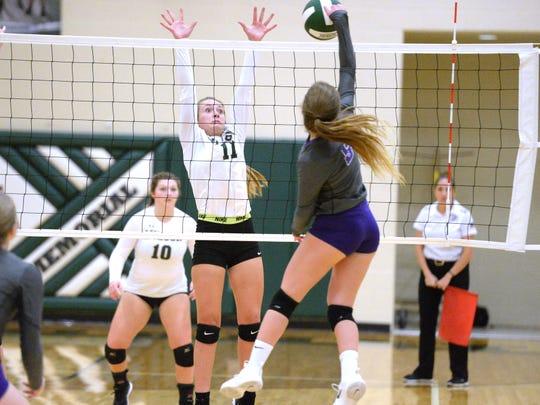Wilson Memorial freshman Brooke Cason works to block a shot by Strasburg in Thursday's Region 2B volleyball win by Wilson.