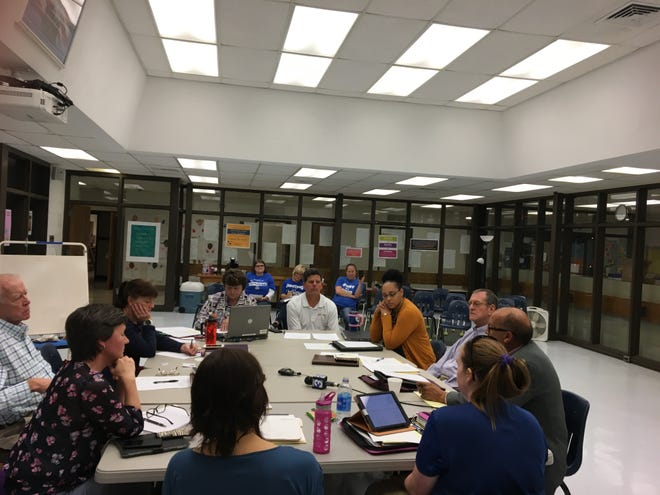 """The Staunton City School Board discussed the name change survey results with """"Save the Name"""" residents watching in back."""