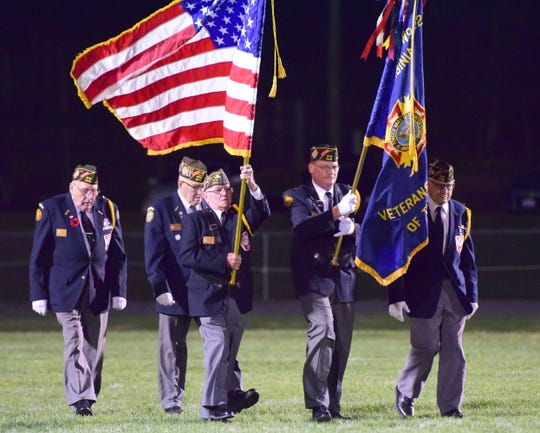 Members of Augusta-Staunton VFW Post 2216 present the colors prior to Buffalo Gap's game against Wilson Memorial on Thursday, Nov. 1, 2018, at Buffalo Gap High School in Swoope, Va. The school held its first Military and First Responder Appreciation Night.