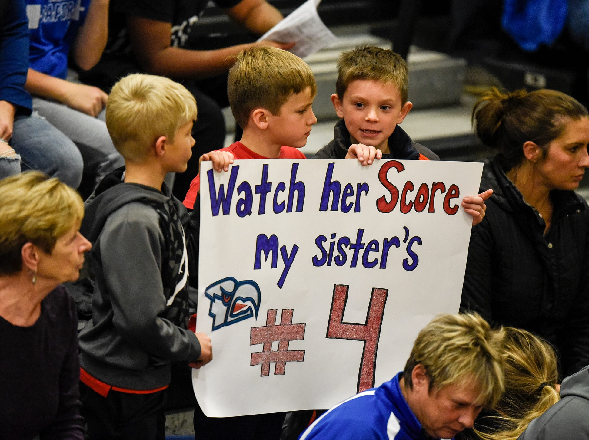 Fans hold signs before the start of the Section 6-2A volleyball semifinals Thursday, Nov. 1, at Sauk Rapids-Rice High School.