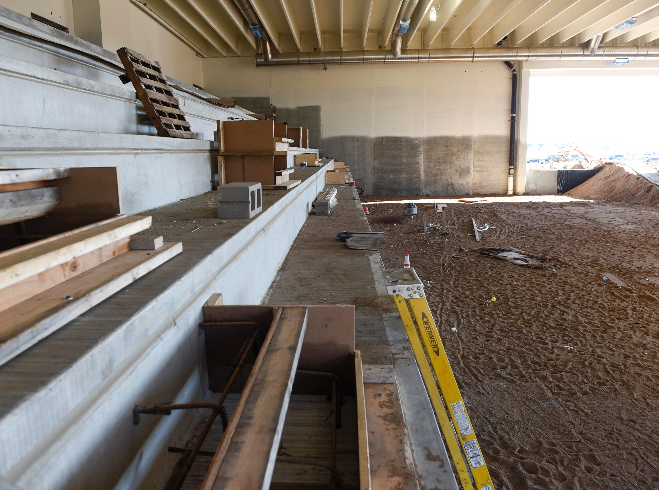 Construction of the pool bleachers Thursday, Nov. 1, at the new Tech High School.