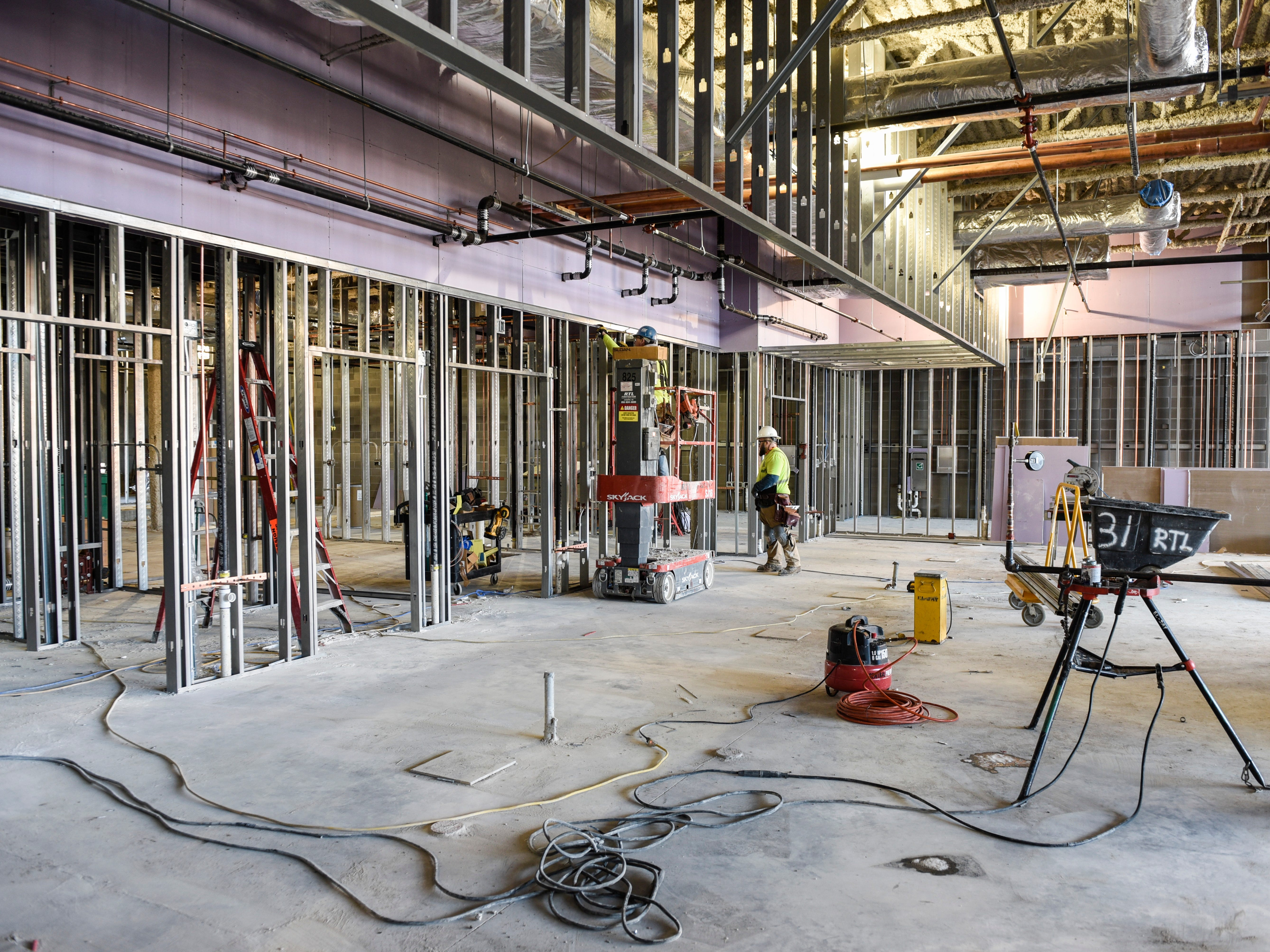 Contractors work on the kitchen area Thursday, Nov. 1, at the new Tech High School.