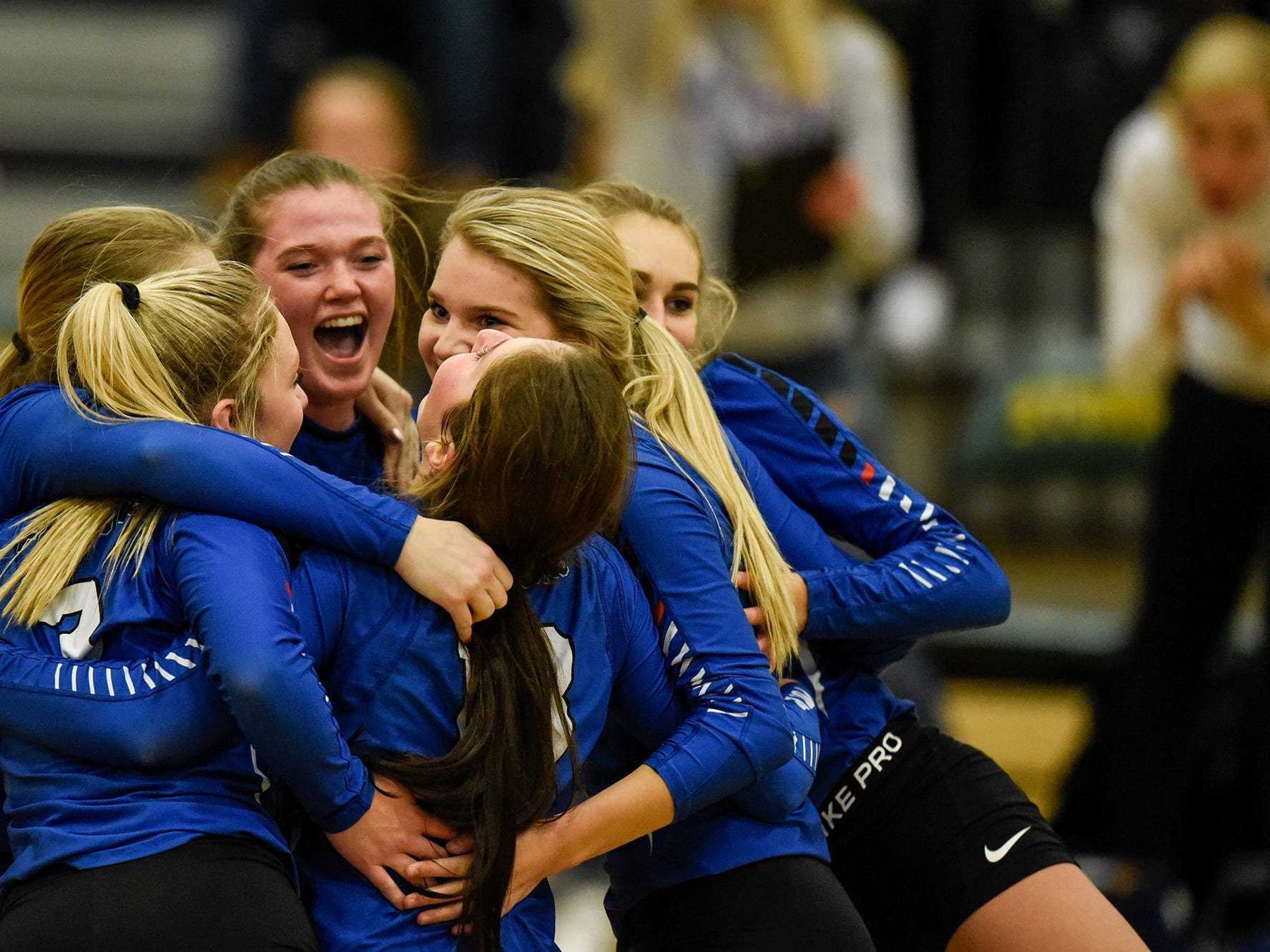 Foley players celebrate a point during the Section 6-2A volleyball semifinals Thursday, Nov. 1, at Sauk Rapids-Rice High School.