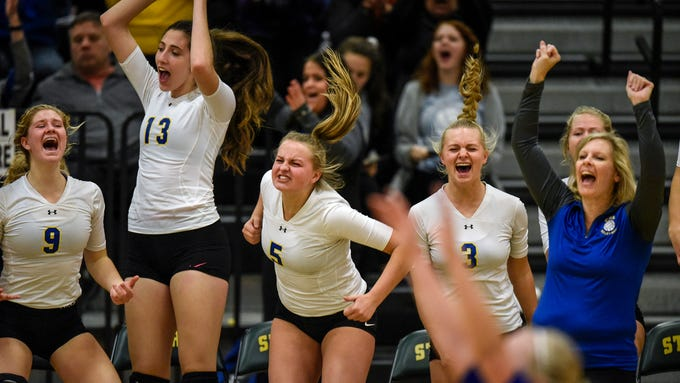 Cathedral players celebrate their 3-0 win against Foley during the Section 6-2A volleyball semifinals Thursday, Nov. 1, at Sauk Rapids-Rice High School.