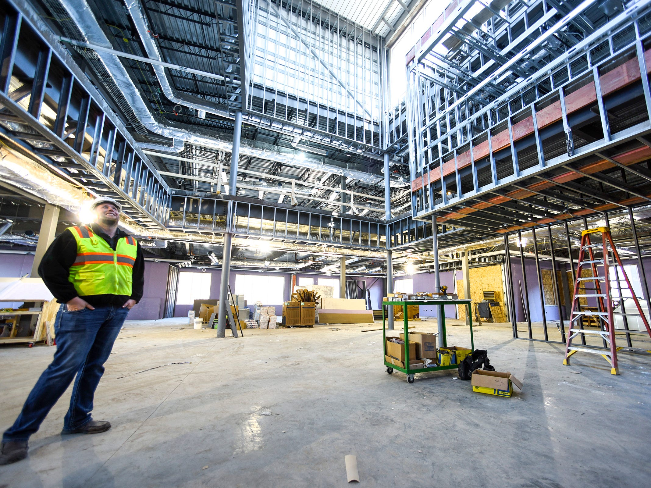 Kyle Walter, ICS Consulting, inspects the progress of one of three learning neighborhoods Thursday, Nov. 1, at the new Tech High School.