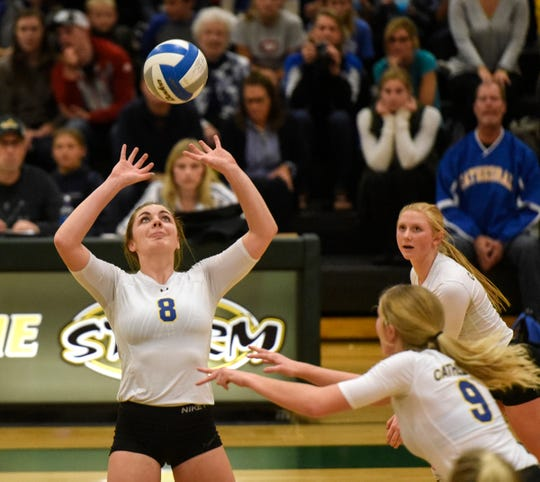 Megan Voit sets the ball up for a teammate during the Section 6-2A volleyball semifinals Thursday, Nov. 1, at Sauk Rapids-Rice High School.