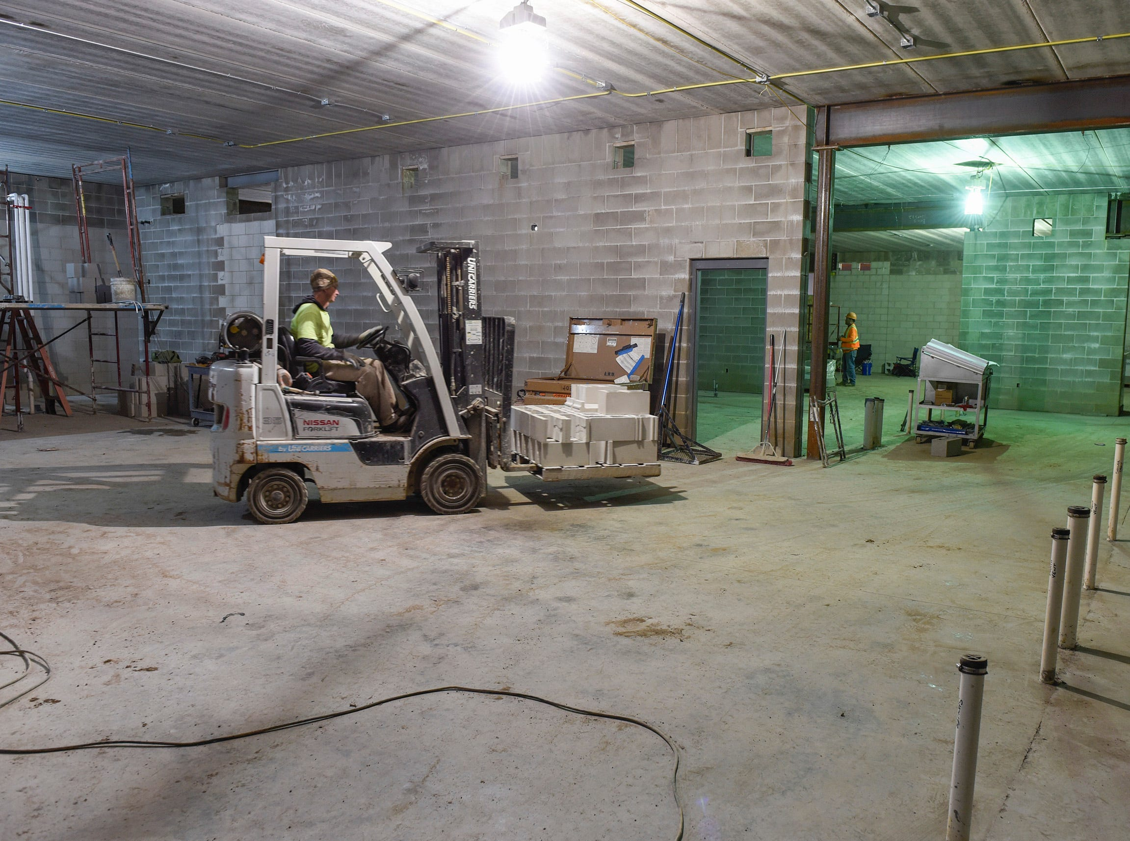 Contractors work on the locker room area Thursday, Nov. 1, at the new Tech High School.