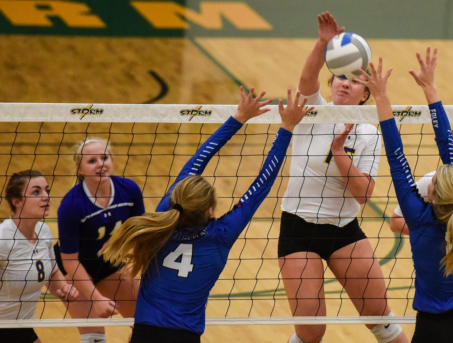 Cathedral's Gabby Heying attempts a kill during the Section 6-2A volleyball semifinals Thursday, Nov. 1, at Sauk Rapids-Rice High School.