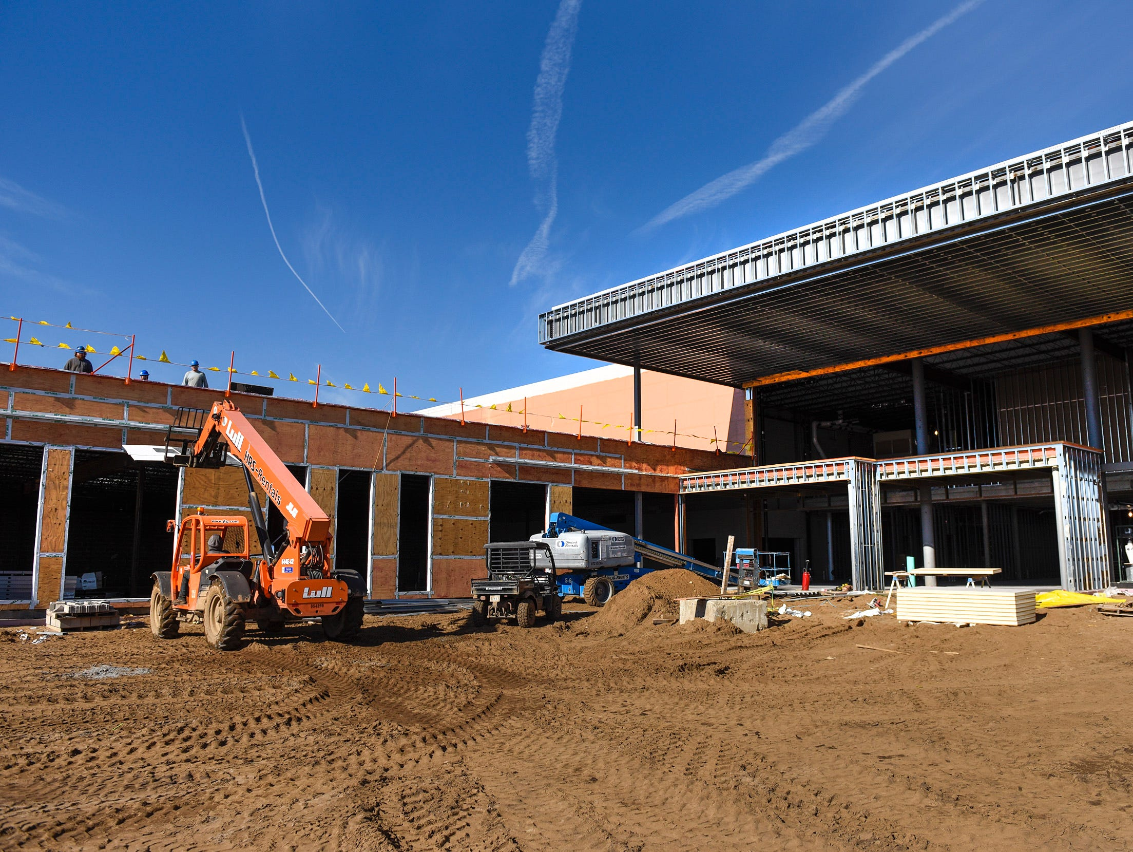 Contractors work on the main entryway Thursday, Nov. 1, at the new Tech High School.