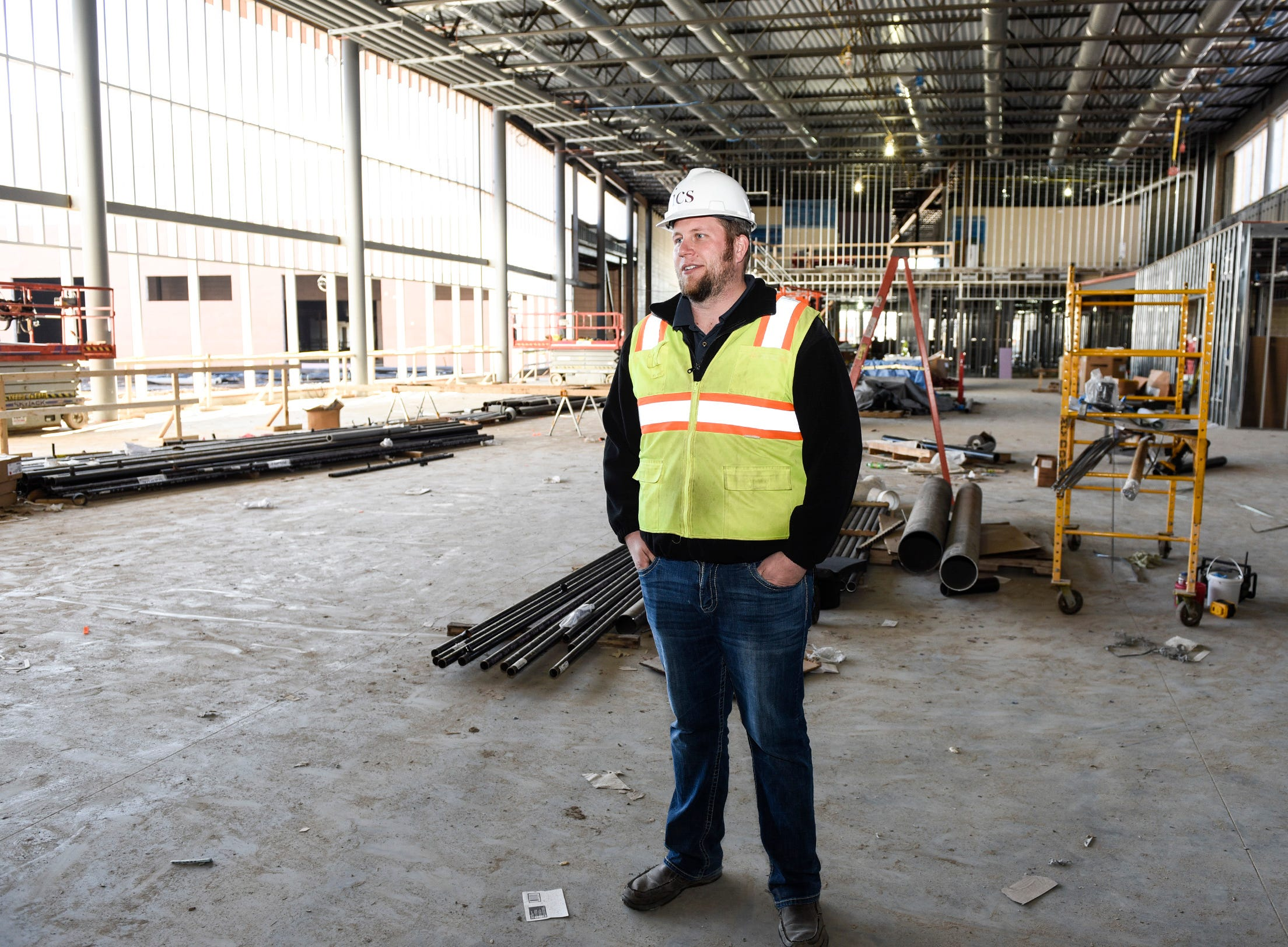 Kyle Walter, ICS Consulting, inspects the progress of the commons area Thursday, Nov. 1, at the new Tech High School.