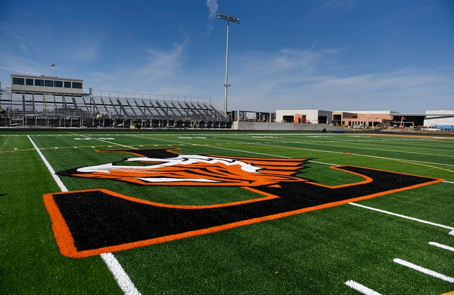 The artificial turf is down and the bleachers are almost complete shown Thursday, Nov. 1, at the new Tech High School.