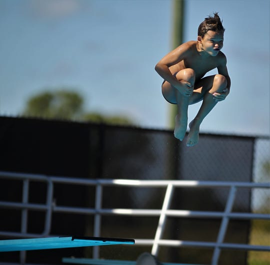 Maclay sixth-grader Maxwell Shaver dives during the 1-meter competition at the District 1-1A swimming and diving meet at Morcom Aquatics Center on Wednesday, Oct. 21, 2018.