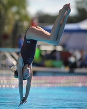 Florida High's Kyla Gilbert dives in the 1-meter competition at the District 1-1A swimming and diving meet at Morcom Aquatics Center on Wednesday, Oct. 21, 2018.