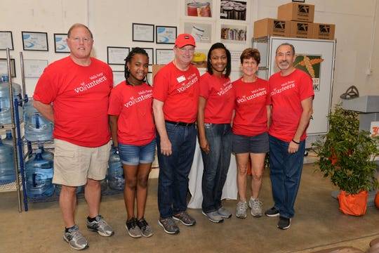 The Wells Fargo Team of Scott Orr, left, Gabrielle Thomas, Earl Morgan, Shelly Thomas, Bonnie Simes and Ademil Castrillo participated in Treasure Coast Food Bank's fourth annual Pack The House event on Oct. 26-27.