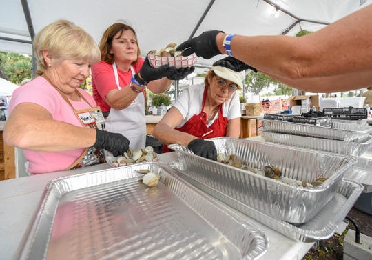 Mollusk lovers relish the abundance of shellfish Friday, Nov. 2, 2018, during the annual Sebastian Clambake at Riverview Park in Sebastian.