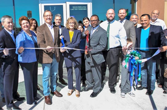 Crystal Long, GECU chief executive officer, and Northeast City Rep. Sam Morgan cut the ribbon at the Oct. 27 ceremony opening the credit union's 17th neighborhood branch at 9435 Dyer St., in Northeast El Paso.