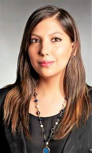 Vinda Rojas,  graphic designer at Mithoff Burton Partners.