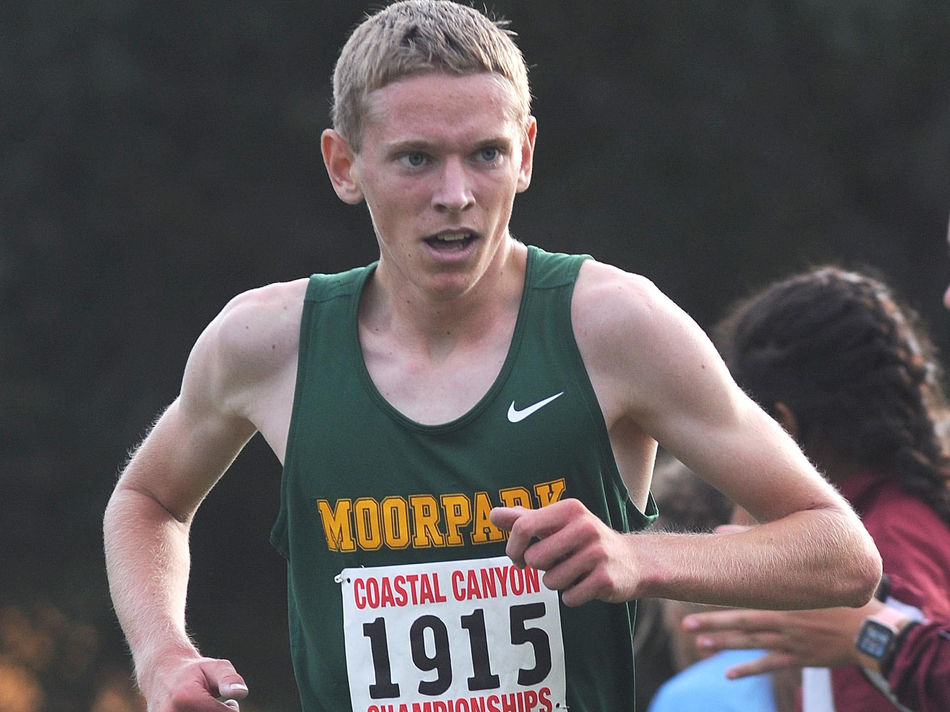 Keith Murray of Moorpark crosses the finish line with a time of 15:55.2 to win the boys race at the Coastal Canyon League championships Thursday at Mission Oaks Park in Camarillo.