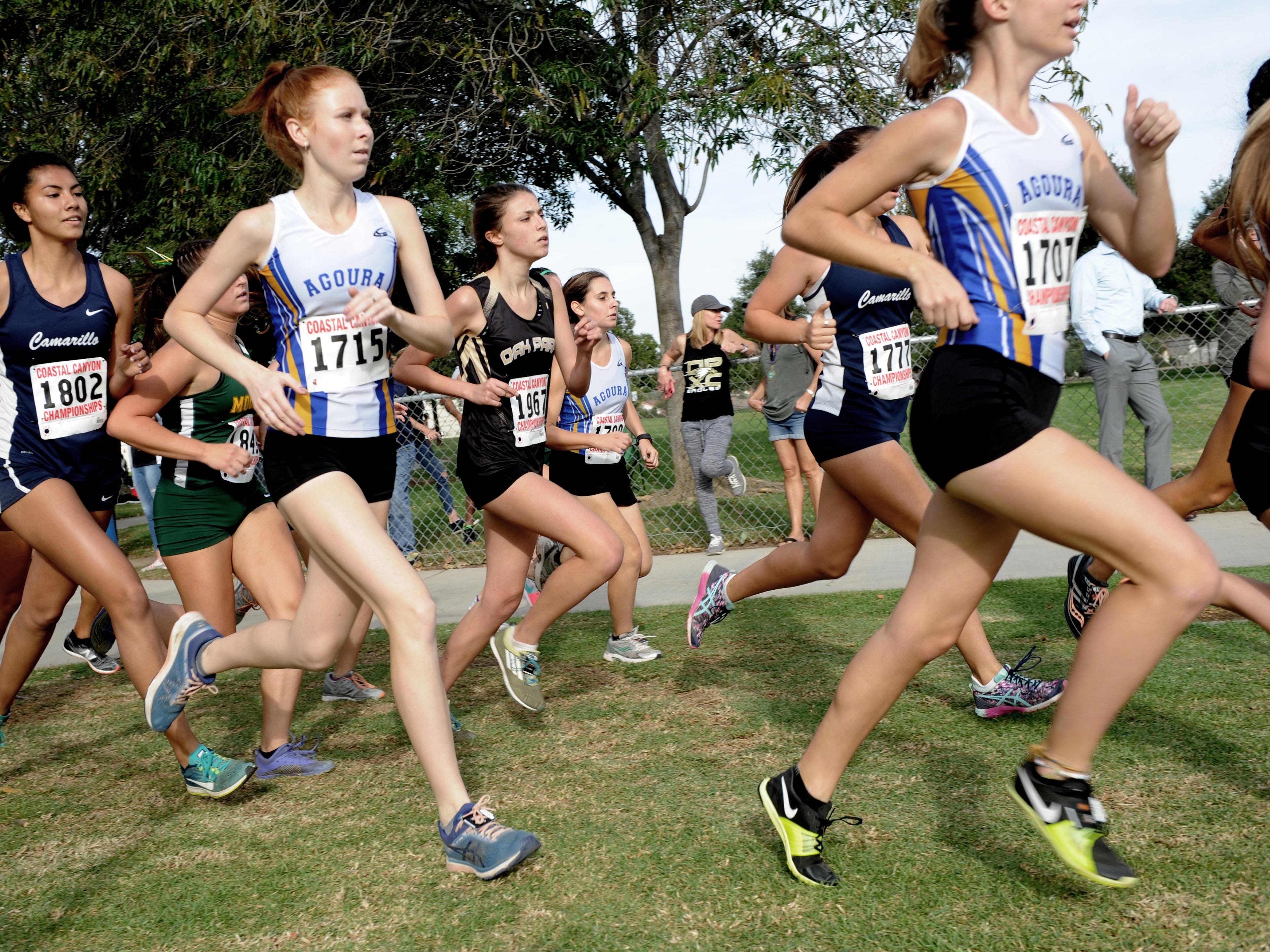 Girls runners compete at the Coastal Canyon League cross country championships Thursday at Mission Oaks Park in Camarillo.