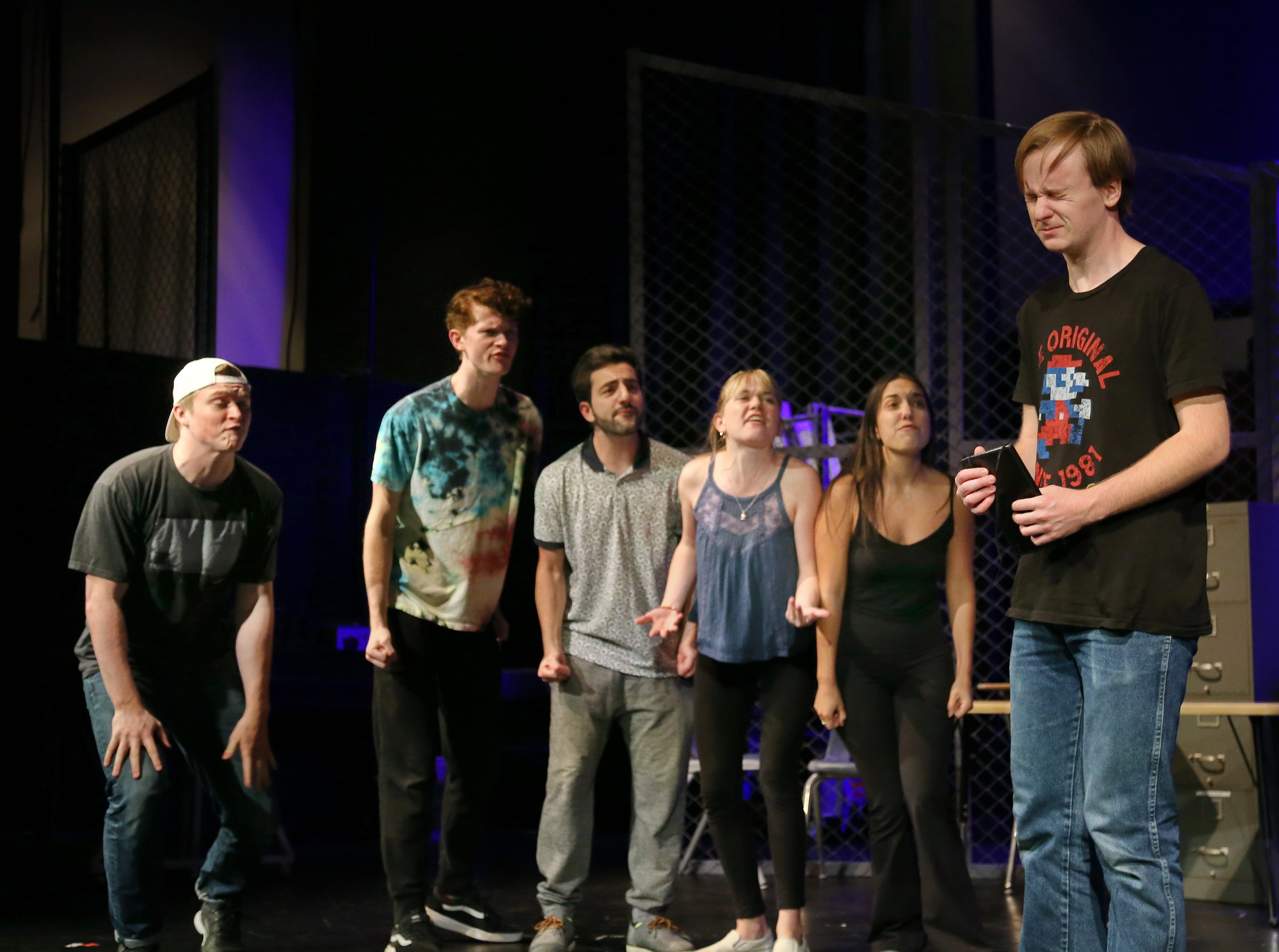 """California Lutheran University drama student Jacob White closes his eyes while getting taunted by Clayton Currie (from left), Jordan Irwin, Mahyar Mirazazadeh, Victoria Karr and Amber Marroqui in the school's production of """"Columbinus.""""  The play is based on the 1999 shooting at Columbine High School in Littleton, Colorado. White plays the role of shooter Dylan Klebold."""