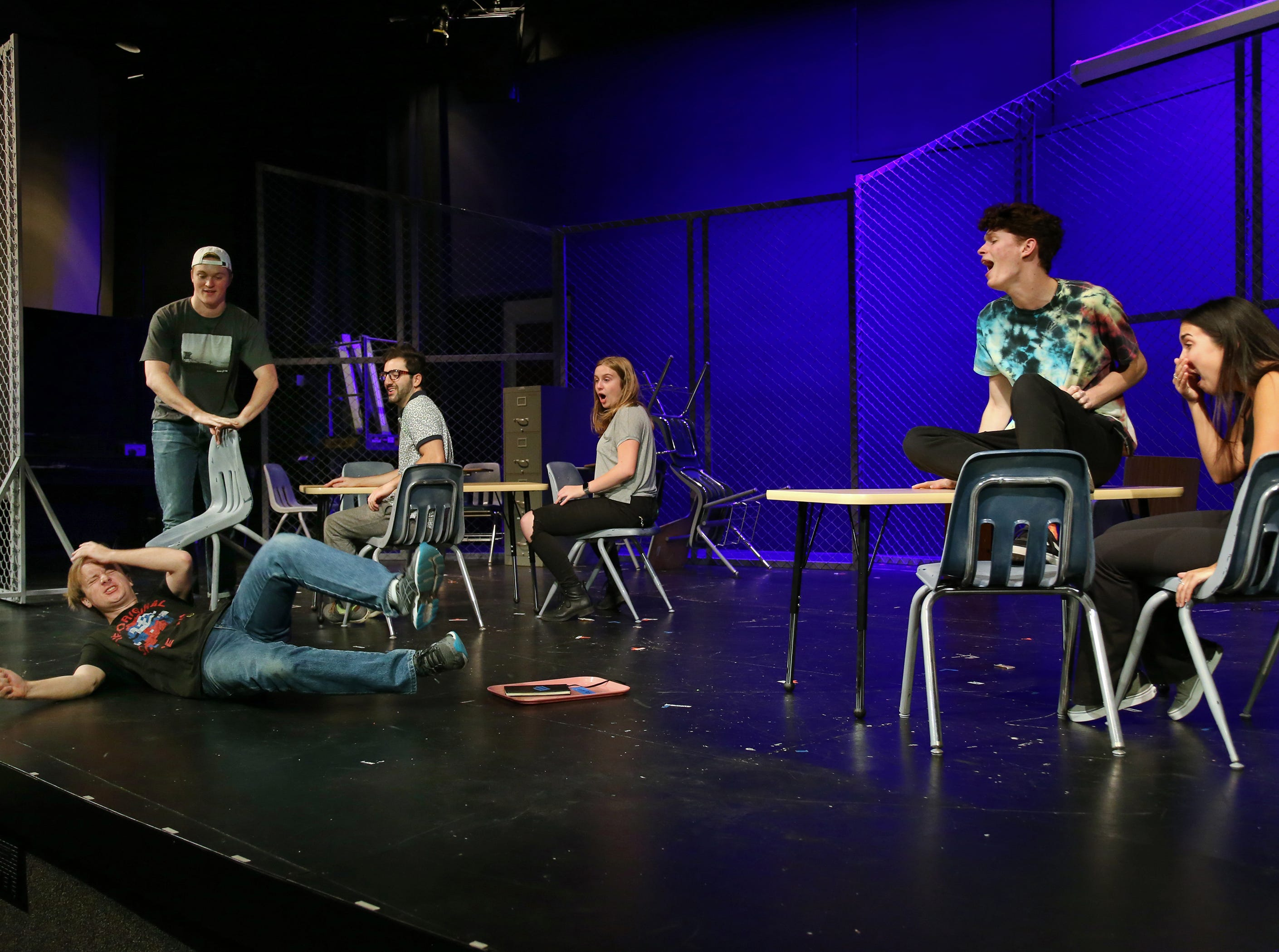 """Jacob White reacts after having his chair pulled out from underneath him by Clayton Currie in California Lutheran University's production of """"Columbinus."""" Sharing the stage are Mahyar Mirazazadeh, Gabrielle Reublin, Jordan Erickson and Amber Marroqui. The director said the increase in school shootings make it important for the play, based on the 1999 shooting at Columbine High School in Littleton, Colorado, to be staged. White plays the role of shooter Dylan Klebold."""