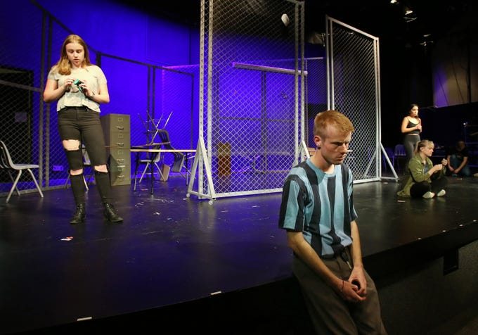 """California Lutheran University drama student Jonathan Irwin shares the stage with Gabrielle Reublin (from left), Victoria Karr and Amber Marroqui in the school's production of """"Columbinus,"""" which starts Thursday at the Preus-Brandt Forum on campus. The play is based on the shooting at Columbine High School in Littleton, Colorado, in 1999. Jonathan plays the role of shooter Eric Harris."""