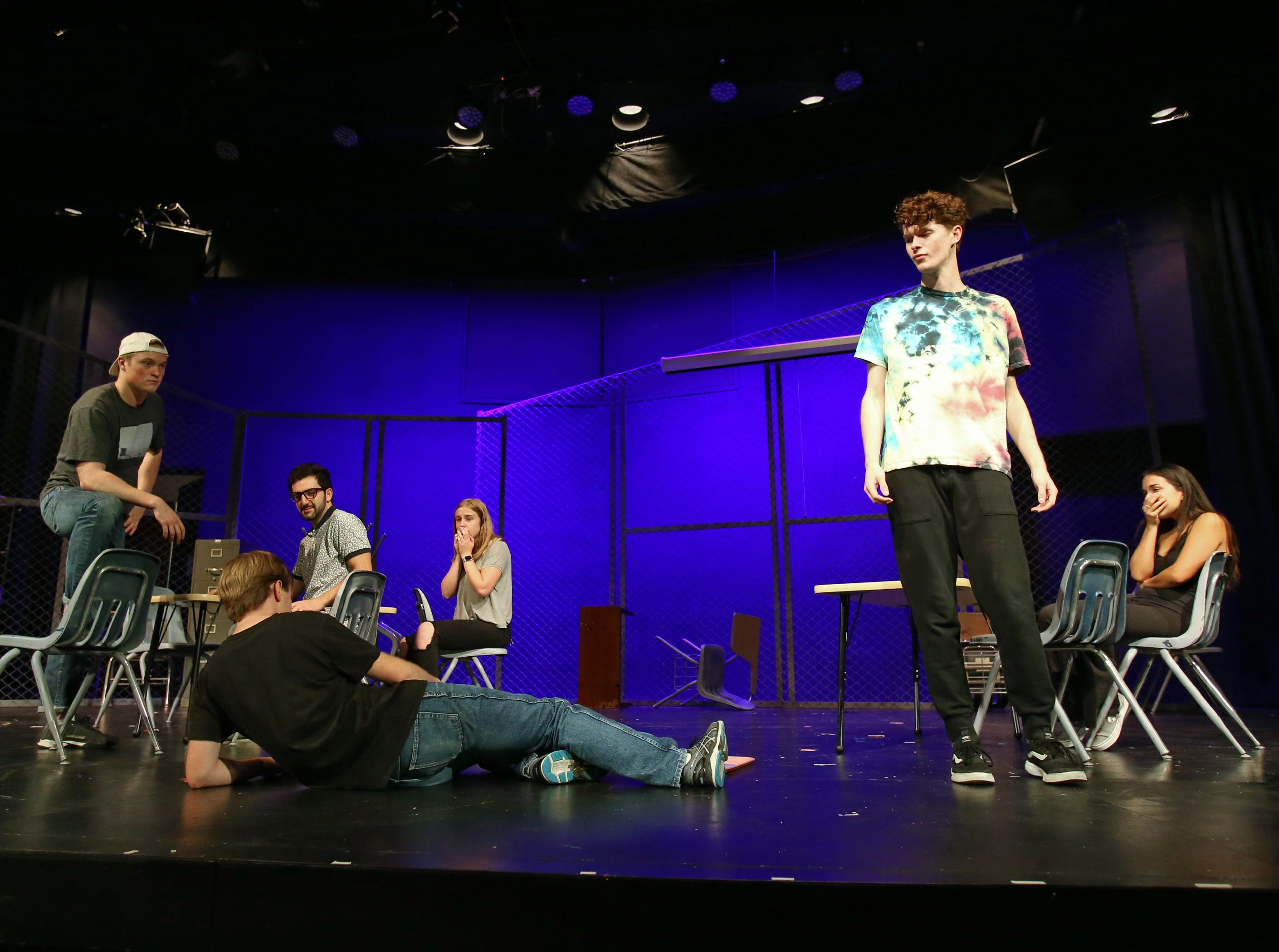 """California Lutheran University drama student Jordan Erickson (right) looks down at Jacob White in one of the power scenes in the school's production of """"Columbinus,"""" which will be staged beginning Thursday at the Preus-Brandt Forum on campus. The play is based on the shooting at Columbine High School in Littleton, Colorado, in 1999. Erickson plays shooter Dylan Klebold in the play that runs through Nov 18."""