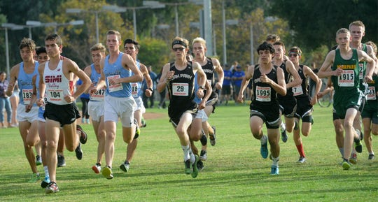 Boys runners compete at the Coastal Canyon League cross country championships Thursday at Mission Oaks Park in Camarillo.