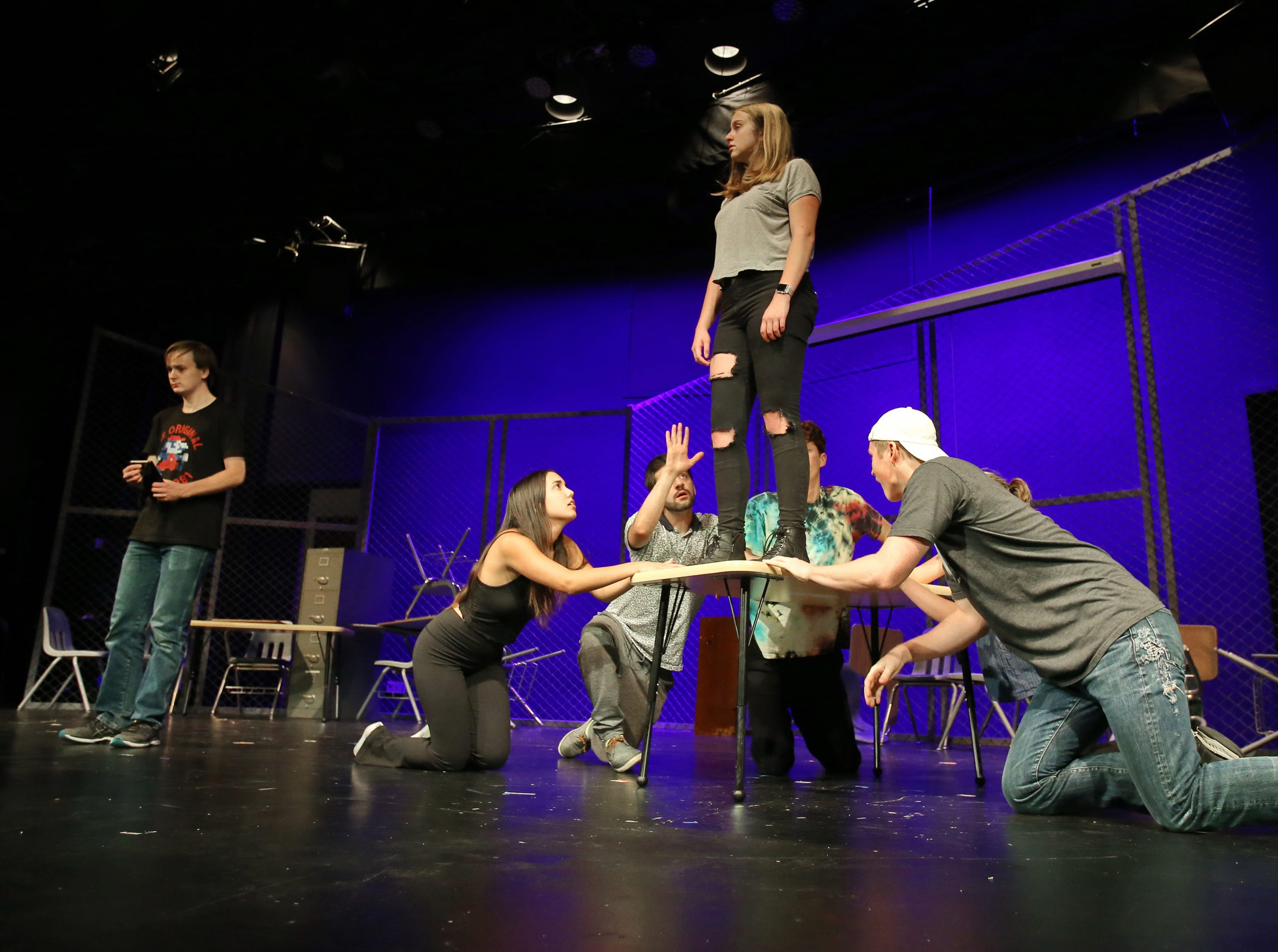 """California Lutheran University drama students Jacob White (left) and Gabrielle Reublin perform one of the scenes in Act 1 with fellow cast members in their production of """"Columbinus."""" The play is based on the 1999 shooting at Columbine High School in Littleton, Colorado, and those involved hope it focuses new attention on the troubling rise in the number of school shootings."""